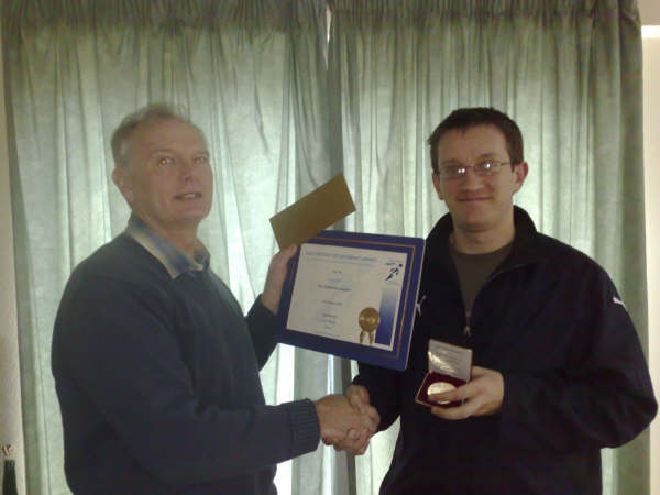 Jan 2009: Dan Sly receives Epping's first Leader's Award from fundraising manager John Brades.